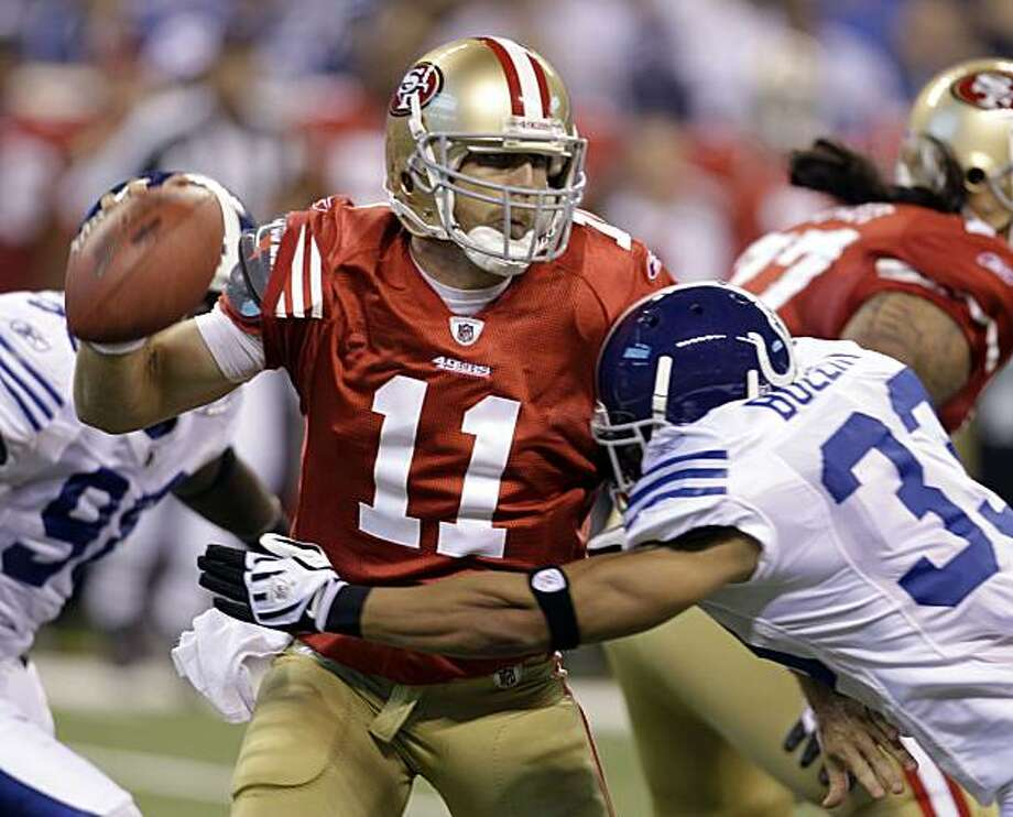 San Francisco 49ers quarterback Alex Smith (11) is hit by Indianapolis Colts defensive back Melvin Bullitt (33) while throwing in the first quarter of an NFL preseason football game in Indianapolis, Sunday, Aug. 15, 2010. Photo: Darron Cummings, AP