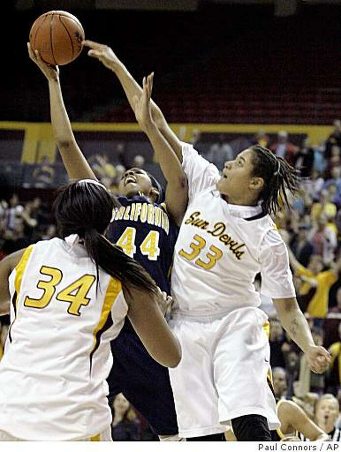 California forward Ashley Walker (44) makes the game-winning basket as she is defended by Arizona State center Sybil Dosty (33) as Arizona State forward Lauren Lacey, bottom, looks on in a game Sunday, Jan. 4, 2009, in Tempe, Ariz. California won 54-53. Photo: Paul Connors, AP