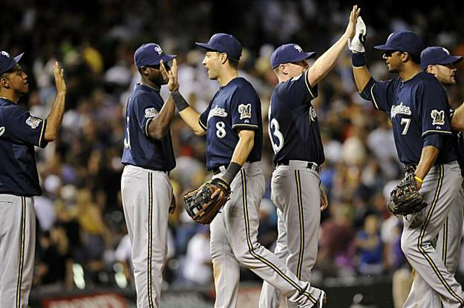 Milwaukee Brewers' left fielder, Ryan Braun, center, celebrates with teammates after defeating the Colorado Rockies in ten innings of a baseball game at Coors Field in Denver, Colo. on Saturday, Aug. 14, 2010. Photo: Matt McClain, AP