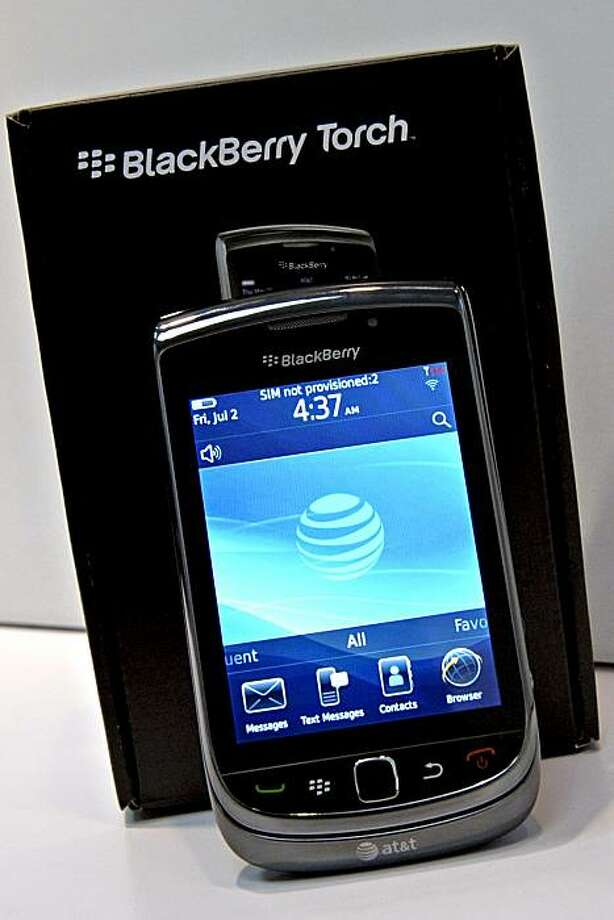 Th BlackBerry Torch smartphone is displayed at an AT&T Inc. wireless store in New York, U.S., on Thursday, Aug. 12, 2010. The new Research In Motion Ltd. (RIM) BlackBerry, which features a slide-out keyboard and the BlackBerry 6 operating system, went on sale today exclusively at AT&T for $199, allowing AT&T to expand its smartphone lineup ahead of a possible loss of its U.S. monopoly for Apple Inc.'s iPhone. Photographer: Peter Foley/Bloomberg Photo: Peter Foley, Bloomberg