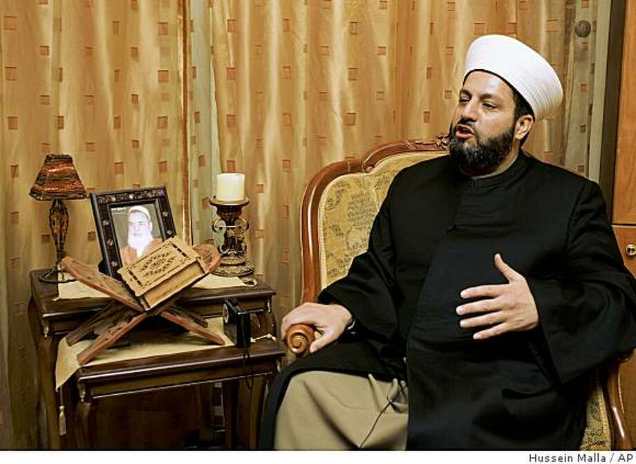 **APN ADVANCE FOR SUNDAY JAN.4**  Sheik Bilal Shaaban, leader of the Islamic Unity Movement, a Tripoli Sunni group with ties to Syria, speaks during an interview with the Associated Press in his home in Tripoli's Abu Samra neighborhood, Lebanon, Thursday, Nov. 27, 2008. Tripoli, a predominantly Sunni Muslim city some 80 kilometers (50 miles) north of Beirut, was the birthplace of Lebanon's Salafi movement in the 1950s and has long been a fertile ground for all sorts of Sunni fundamentalism. Today, it is at the center of a trend toward rising militancy, fueled in part by a regional power struggle between Saudi Arabia and Syria through their local Lebanese extensions. (AP Photo/Hussein Malla) Photo: Hussein Malla, AP