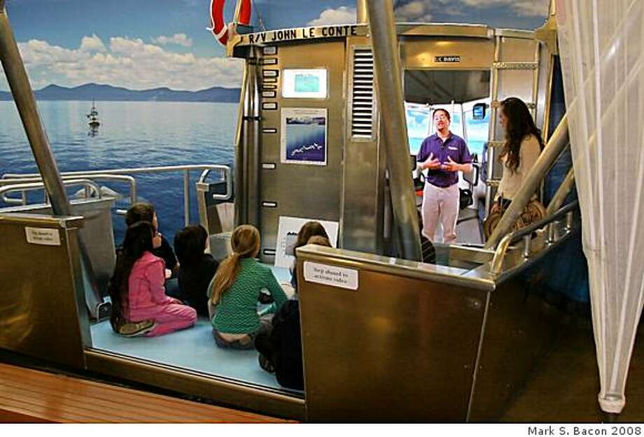 Docent Anna Simmons watches as a recorded video guide talks to students from Tahoe Lake Elementary School aboard a mockup of the UC Davis research vessel at the Tahoe Center for Environmental Sciences in Incilne Village. Photo: Mark S. Bacon 2008