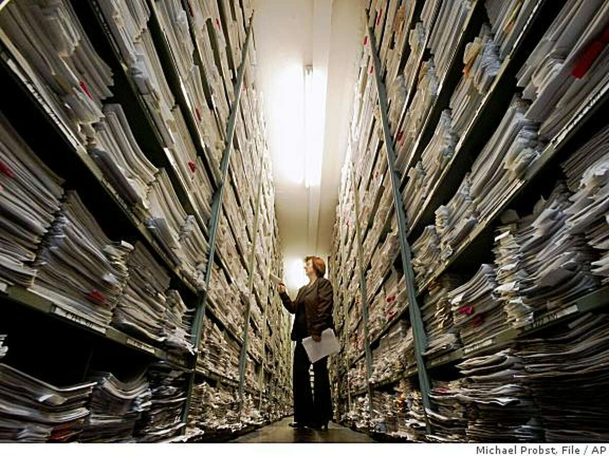 ** FILE ** This Nov. 9, 2006 file photo shows Maria Raabe, Head of Central Secretariat at the International Tracing Service (ITS) in the correspondence archive in Bad Arolsen, Germany. This vast archive, 16 miles of files in six nondescript buildings in the German spa town, contains the fullest records of Nazi persecutions in existence. (AP Photo/Michael Probst, File)