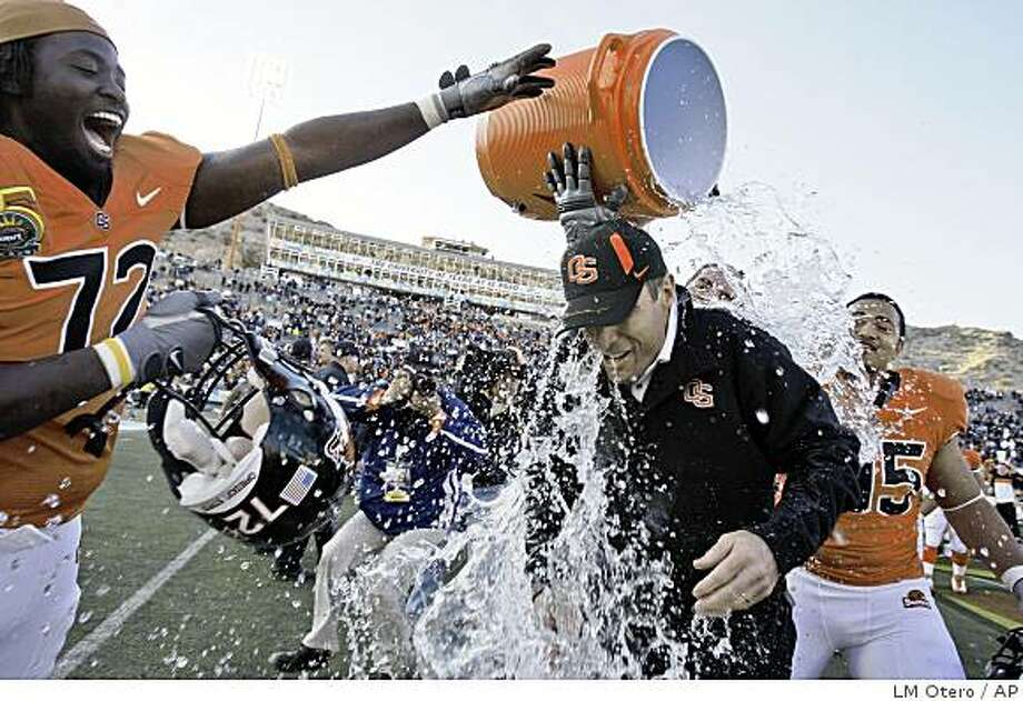 Players douse Oregon State coach Mike Riley after Oregon State's 3-0 win over Pittsburgh in the Sun Bowl NCAA college football game in El Paso, Texas, Wednesday, Dec. 31, 2008. (AP Photo/LM Otero) Photo: LM Otero, AP