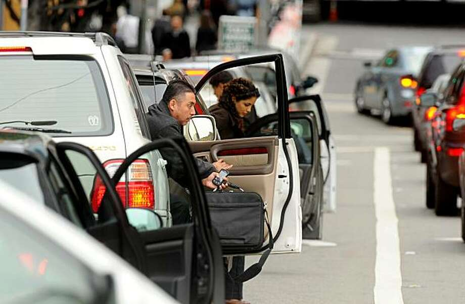 Casual carpoolers exit vehicles on Fremont St. during morning commute on Thursday, Aug. 12, 2010, in San Francisco. Photo: Noah Berger, Special To The Chronicle