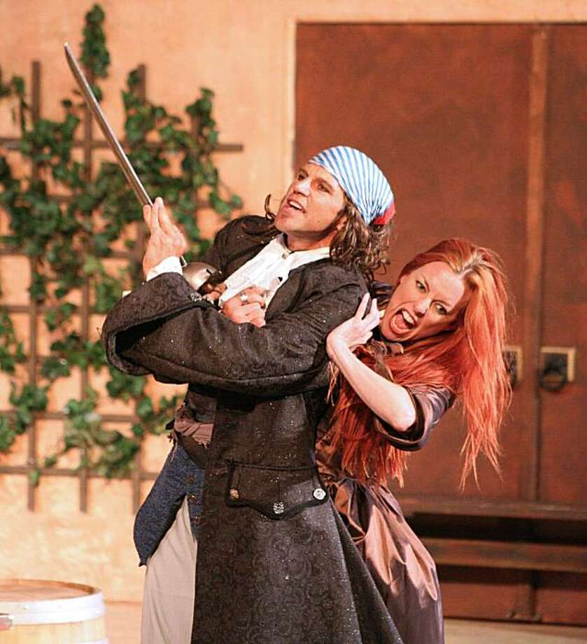 "The wooing of Cat Thompson as Kate by Darren Bridgett as Petruchio in Marin Shakespeare Company's pirate version of ""The Taming of the Shrew"" Photo: Megan Cowin"