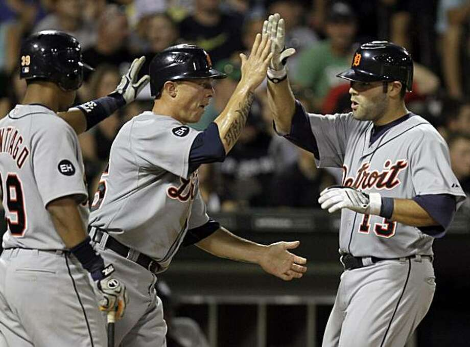 Detroit Tigers' Alex Avila, right, celebrates with Brandon Inge, center, and Ramon Santiago after hitting a two-run home run against the Chicago White Sox during the ninth inning of a baseball game in Chicago, Saturday, Aug. 14, 2010. The Tigers won 3-2. Photo: Nam Y. Huh, AP