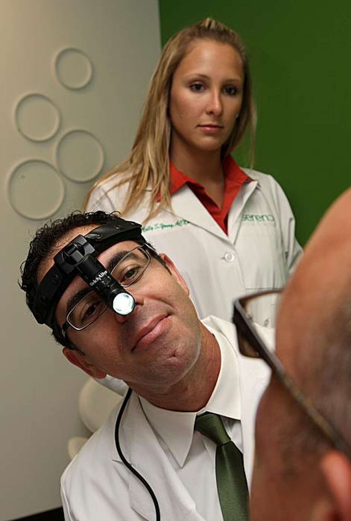 Dr. Matthew Mingrone, the medical director at Sereno, and nurse practioner Molly Young in the examination room in San Francisco, Calif., on Friday, July 16, 2010.
