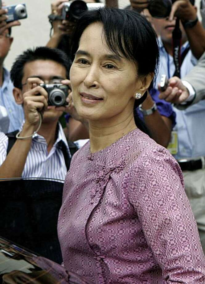 FILE - In this Nov. 4, 2009 file photo, Myanmar's detained opposition leader Aung San Suu Kyi exits the Inya Lake Hotel after meeting with U.S. Assistant Secretary of State Kurt Campbell in Yangon, Myanmar.  Myanmar's ruling junta said the country's firstelection in two decades will be held Nov. 7, finally announcing a date Friday, Aug. 13,2010,  for long-awaited polls that critics have dismissed as a sham designed to cement military rule.  Foreign governments have urged Myanmar to ensure the polls are open, fair and include the party of detained pro-democracy icon Aung San Suu Kyi. But her party already had decided to boycott the vote, saying the junta imposed unfair rules including ones that effectively bar the Nobel Peace laureate from being a candi Photo: Khin Maung Win, AP