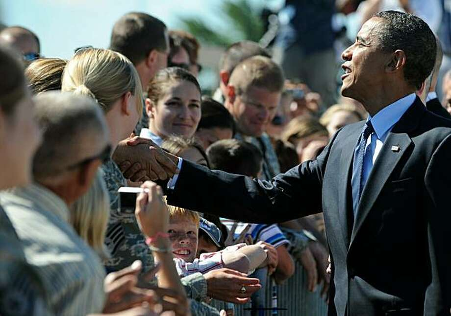 President Barack Obama greets soldiers and their family members upon arriving in Milwaukee, Wisconsin, on August 16, 2010. Photo: Jewel Samad, AFP/Getty Images
