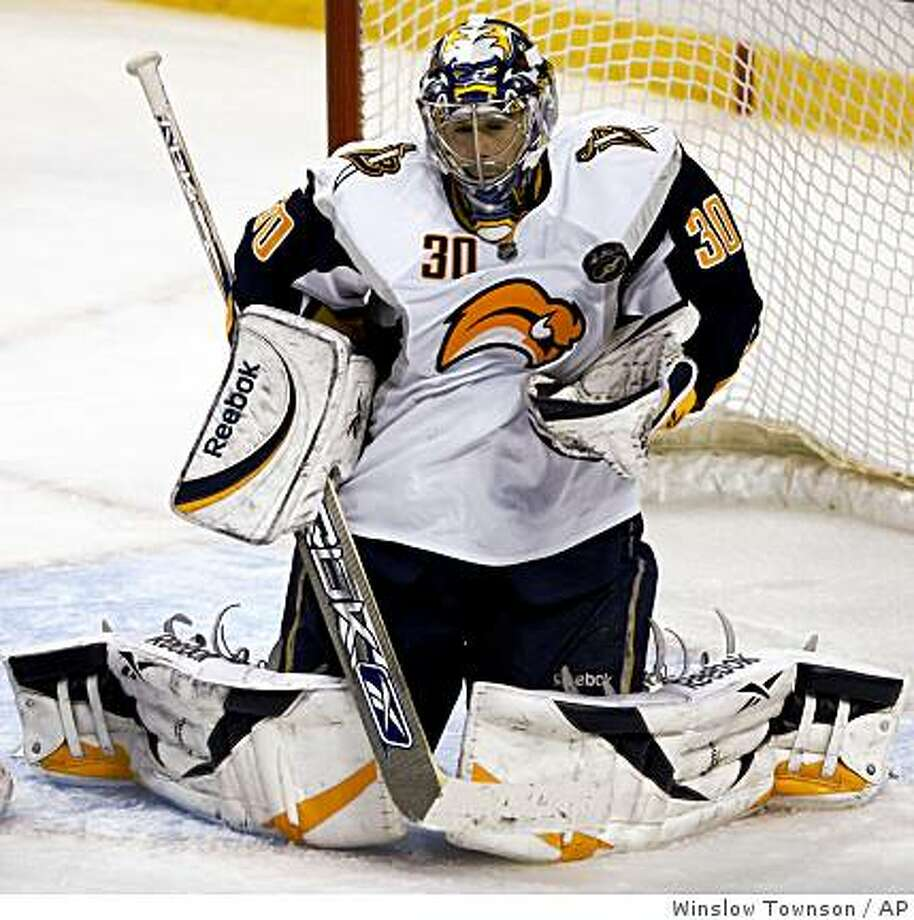Buffalo Sabres goalie Ryan Miller makes a save during the third period of their 4-2 win over the Boston Bruins in an NHL hockey game in Boston Saturday, Jan. 3, 2009. (AP Photo/Winslow Townson) Photo: Winslow Townson, AP