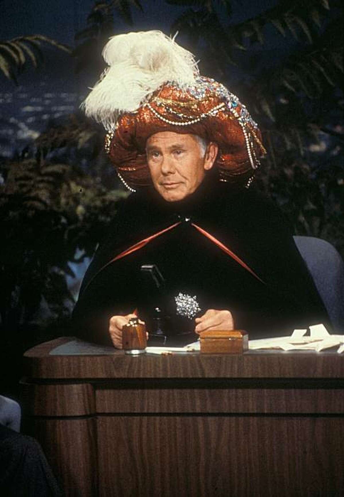 """In this undated photo provided by NBC, Johnny Carson begins an episode of the """"Tonight Show"""" as """"Carnac, The Magnificent!"""""""