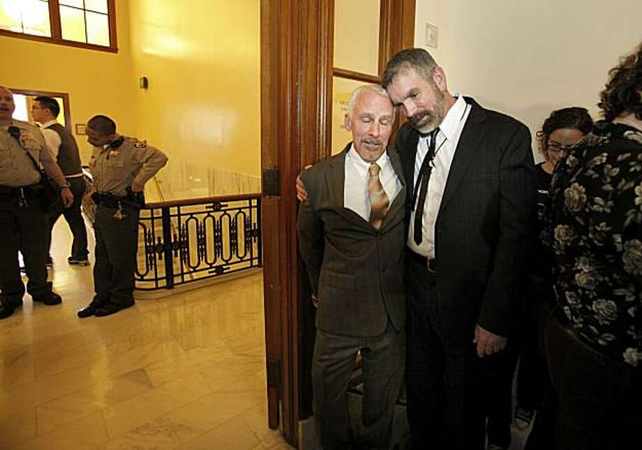 Roger Hunt (left) and Rod Wood (right) who were first in line to get married sadly held each other as it became apparent they would not be able to marry on Thursday.  Law officials kept anyone from actually entering the clerks office. After US District Court Judge Vaughn Walker lifted a stay on samesex marriages Thursday August 12, 2010, hopes were dashed after it was revealed that the lifting of the stay won't go into effect until August 18. Photo: Brant Ward, The Chronicle