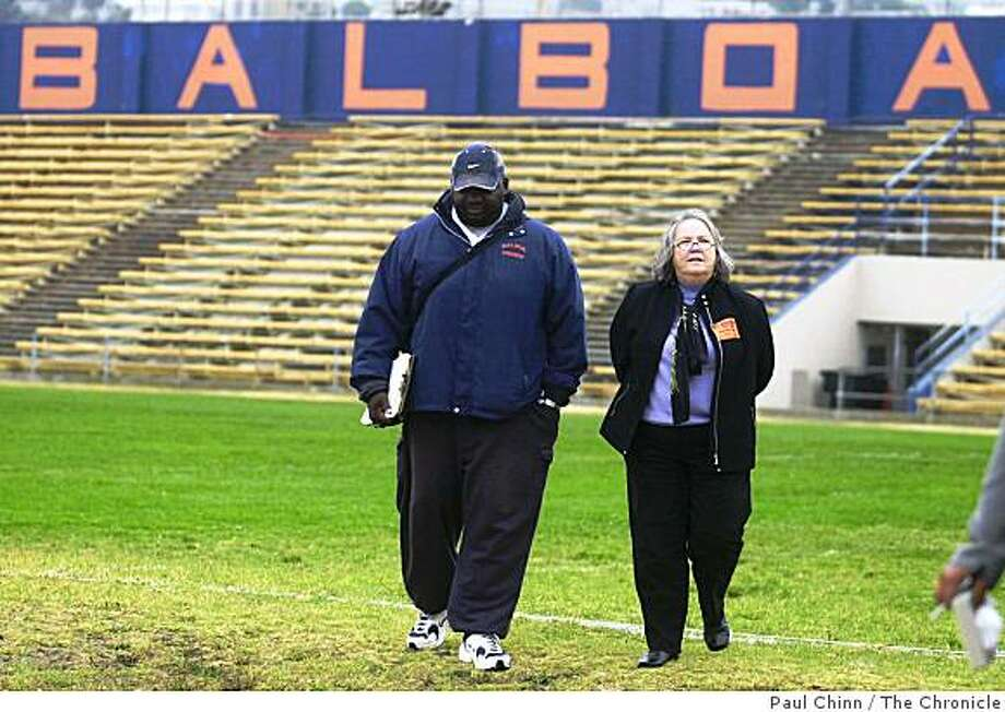Balboa High head coach Keith Minor and campaign manager Novella Smith walk across the football field after touring the team's antiquated locker room. Proposition A school bond measure. San Photo: Paul Chinn, The Chronicle