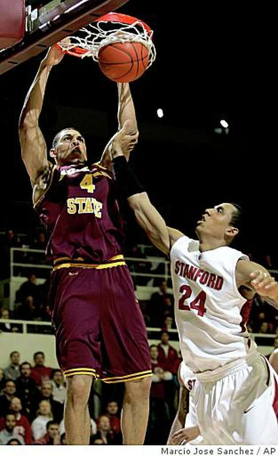Arizona State's Jeff Pendergraph, left, dunks over Stanford's Josh Owens in the first half of an NCAA college basketball game in Stanford, Calif., Friday, Jan. 2, 2009. (AP Photo/Marcio Jose Sanchez) Photo: Marcio Jose Sanchez, AP