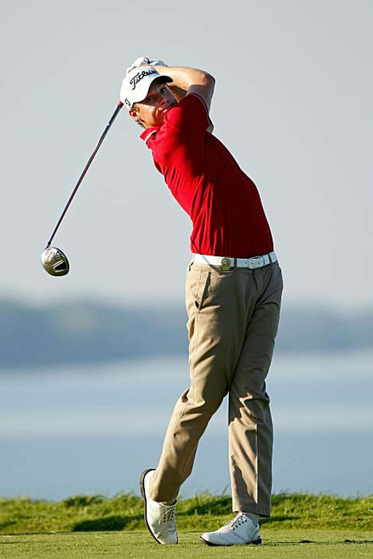 KOHLER, WI - AUGUST 14: Nick Watney hits a tee shot on the 16th hole during the third round of the 92nd PGA Championship on the Straits Course at Whistling Straits on August 14, 2010 in Kohler, Wisconsin.