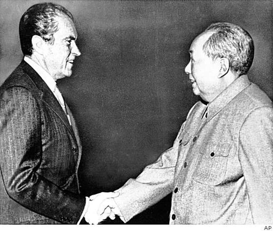 ** FILE** In this Feb 21, 1972 file photo, U.S. President Richard M. Nixon, left, shakes hands with Chinese communist party leader Chairman Mao Zedong during Nixon's groundbreaking trip to China, in Beijing. Forged in absolute secrecy at the height of the Cold War 30 years ago, the diplomatic ties established between the United States and China were meant to balance out the Soviet threat. (AP Photo/File) Photo: AP