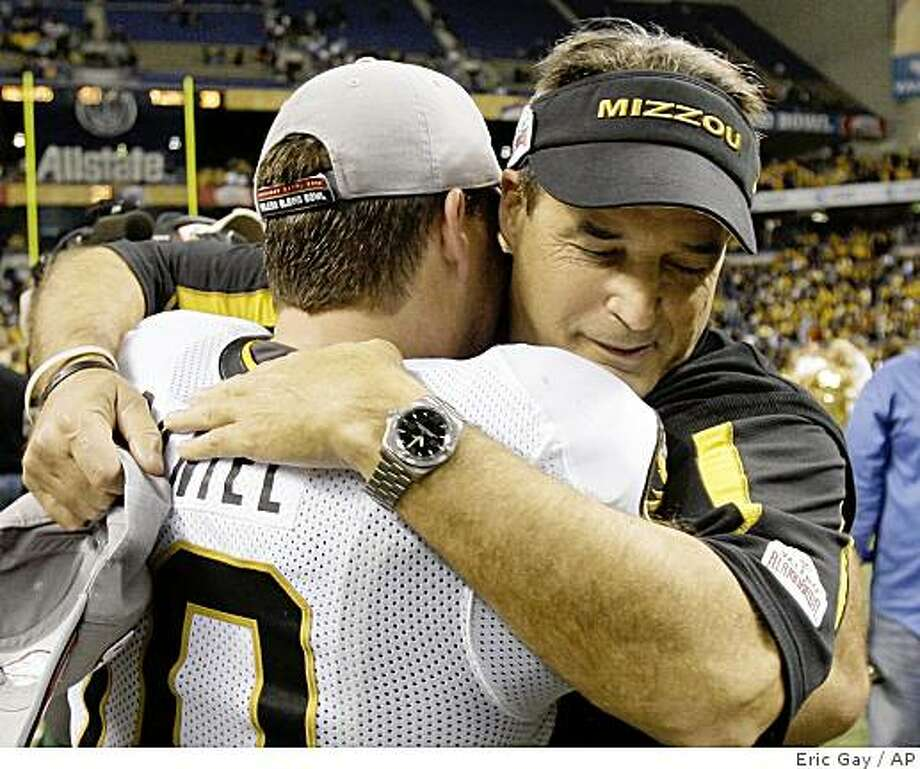 Missouri coach Gary Pinkel, right, hugs quarterback Chase Daniel, left, after Missouri defeated Northwestern in the Alamo Bowl in San Antonio, Monday, Dec. 29, 2008. Photo: Eric Gay, AP