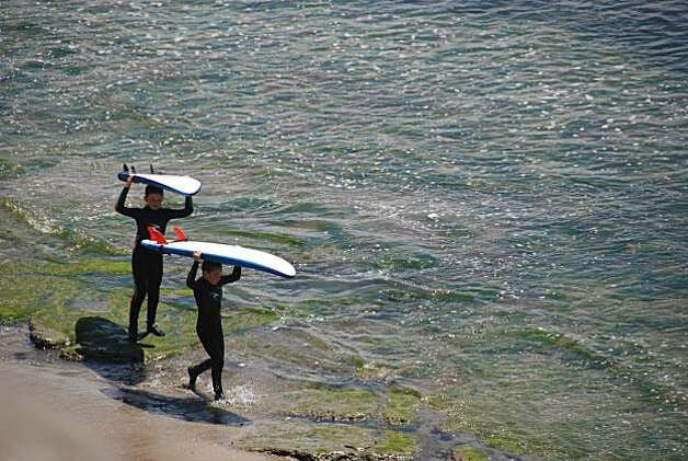 Young surfers search for waves near the Hook, a popular surfing spot in Santa Cruz. Photo: Jill K. Robinson, Special To The Chronicle