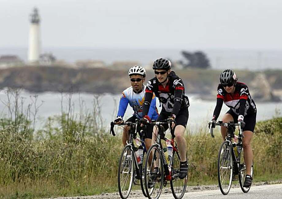 Bicyclists doing the AIDS/Lifecycle ride pass the lighthouse along Highway 1 as they make their way to Santa Cruz in 2009. Photo: Carlos Avila Gonzalez, The Chronicle