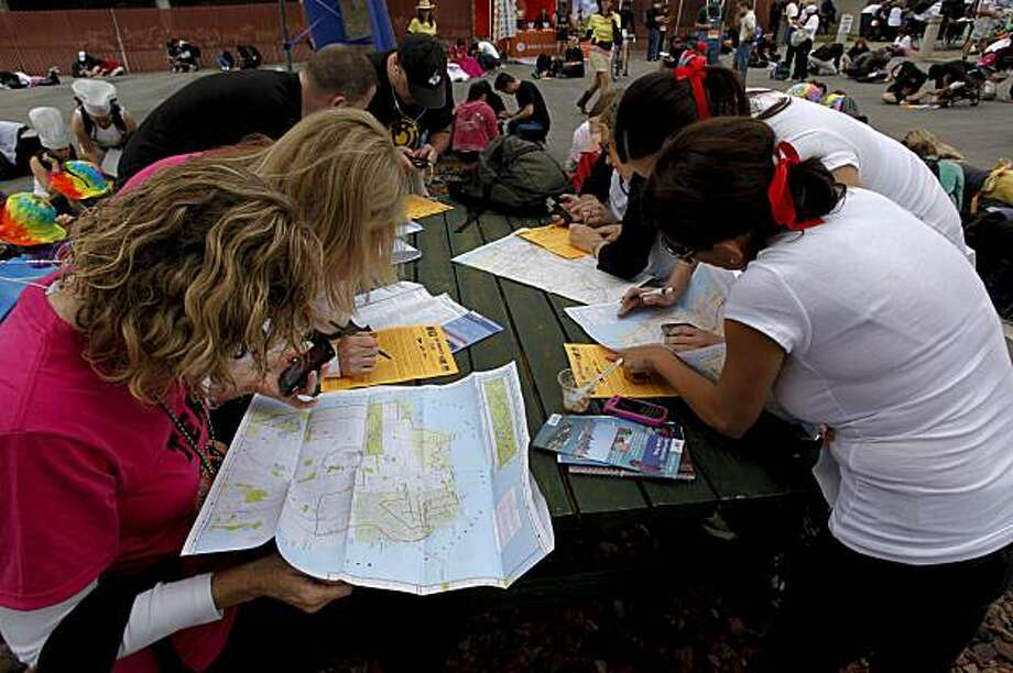 Teams pour over maps, hand held devices and clues as they plot their courses for the race, as they take part in the Great Urban Race through the streets of San Francisco, Calif., on Saturday August 14, 2010. Photo: Michael Macor, The Chronicle