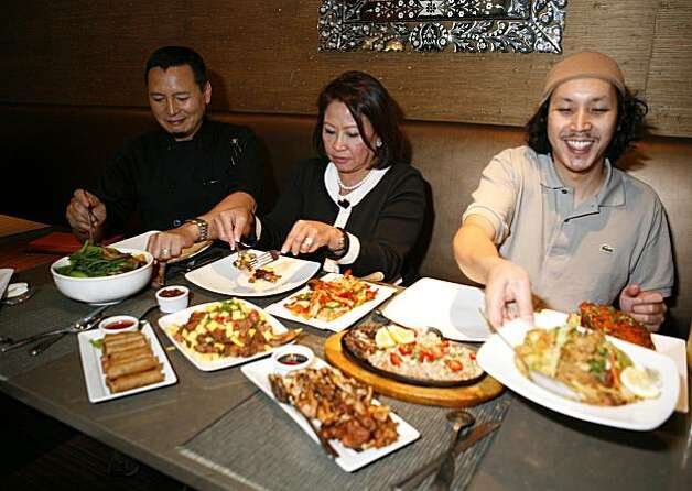 Tim Luym, former chef of Poleng Lounge, (right), Sonia Delen (center), co-owner of Intramuros, and Barry Picazo (right), executive chef at Intramuros are surrounded by various Filipino dishes at Intramuros, a Filipino restaurant that blends modern and traditional Filipino cuisine on Thursday July 29, 2010 in South San Francisco, Calif. Photo: Jasna Hodzic, The Chronicle