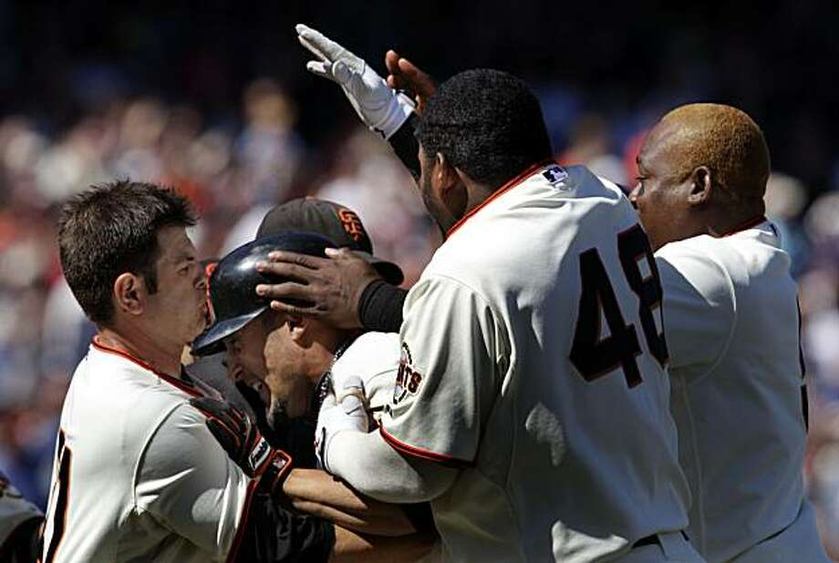San Francisco Giants' Andres Torres is greeted by his teamamtes after hitting a game winning single that allowed Aaron Rowand to score from 3rd base in the 9th inning. The Giants won the four game series taking three of four at AT&T Park in San Francisco Thursday August 12, 2010. Photo: Lance Iversen, The Chronicle