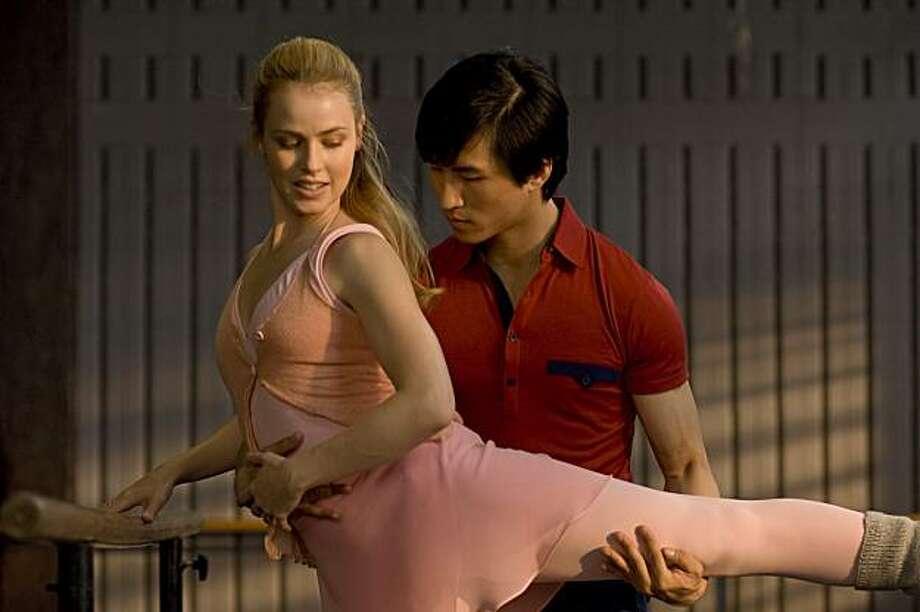 "Amanda Schull as Liz and Chi Cao as Li in ""Mao's Last Dancer."" Photo: Simon Cardwell, Samual Goldwyn Films"