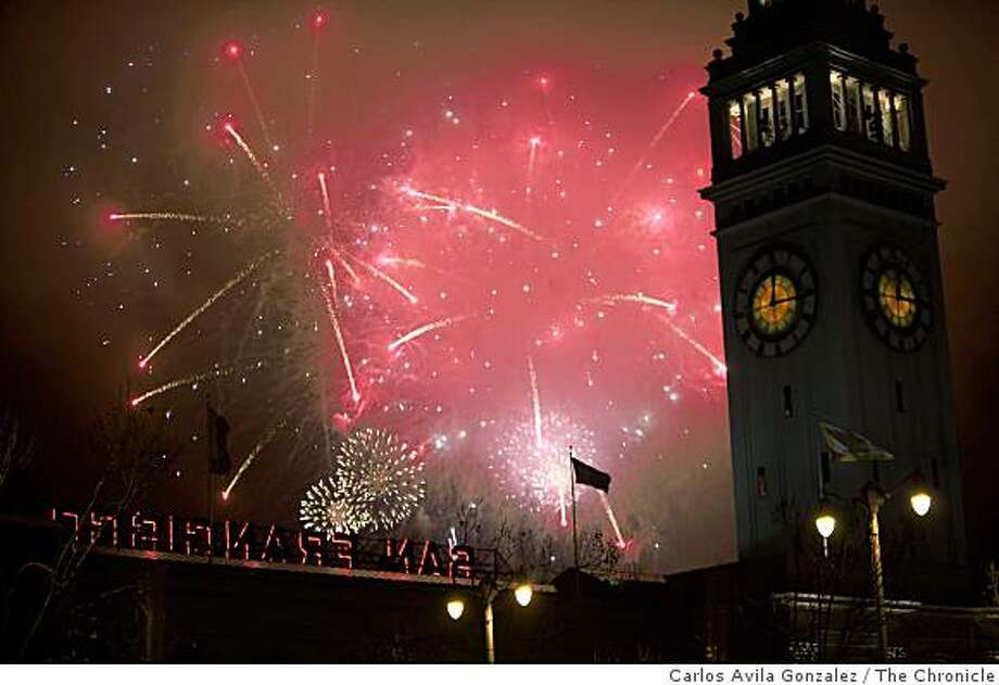 Fireworks light up the sky behind the Ferry Building on San Francisco's Embarcadero as the New Year emerges. Click ahead to see some of the most expensive events in town. Photo: Carlos Avila Gonzalez, The Chronicle