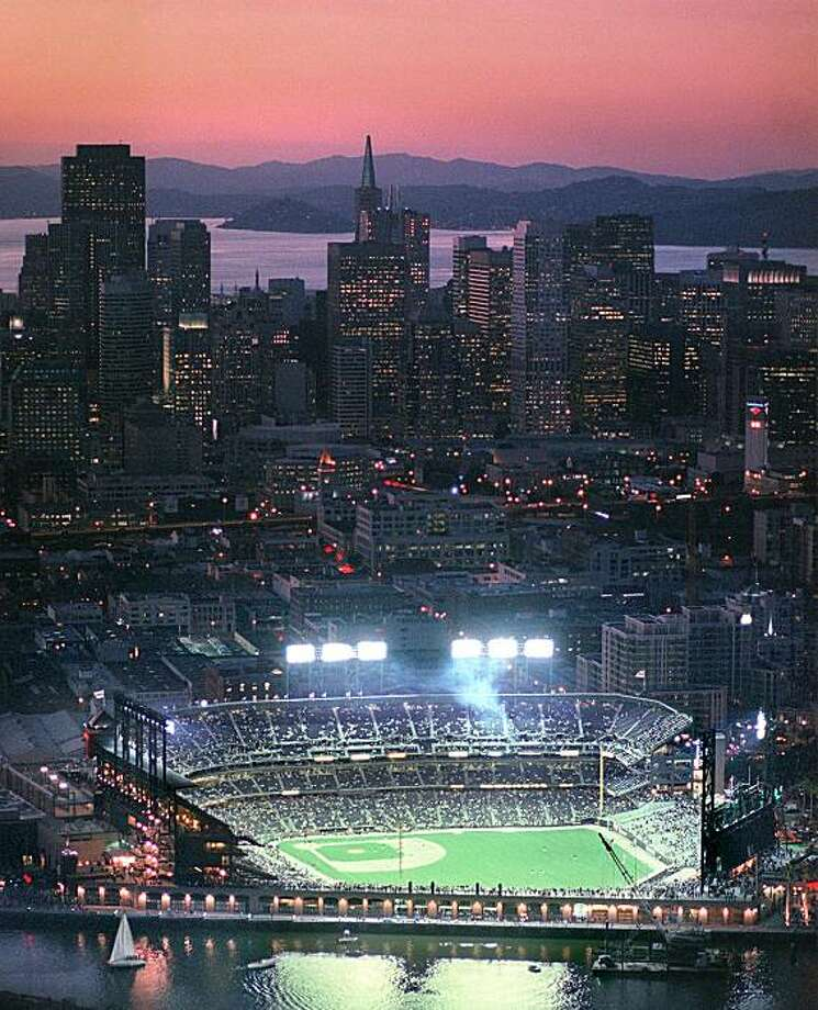 PACBELL-31MAR00-MN-BW--Aerial of Pac Bell Park as the stadium begins to fill up about an hour before first pitch.  Pac Bell Park is nestled around the newly developing MultiMedia gulch along the Embarcadero and the San Francisco city skyline at sunset. By Brant Ward/Chronicle (SPECIAL SECTION) ALSO RAN 02/27/2002(bu), 01/04/04 mn  PacBell Park, giants Photo: Brant Ward, The Chronicle