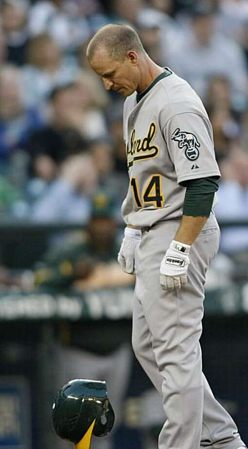 Oakland Athletics' Mark Ellis reacts after striking out to Seattle Mariners' Felix Hernandez during fourth the inning of a baseball game in Seattle Tuesday, Aug. 10, 2010. Photo: John Froschauer, AP