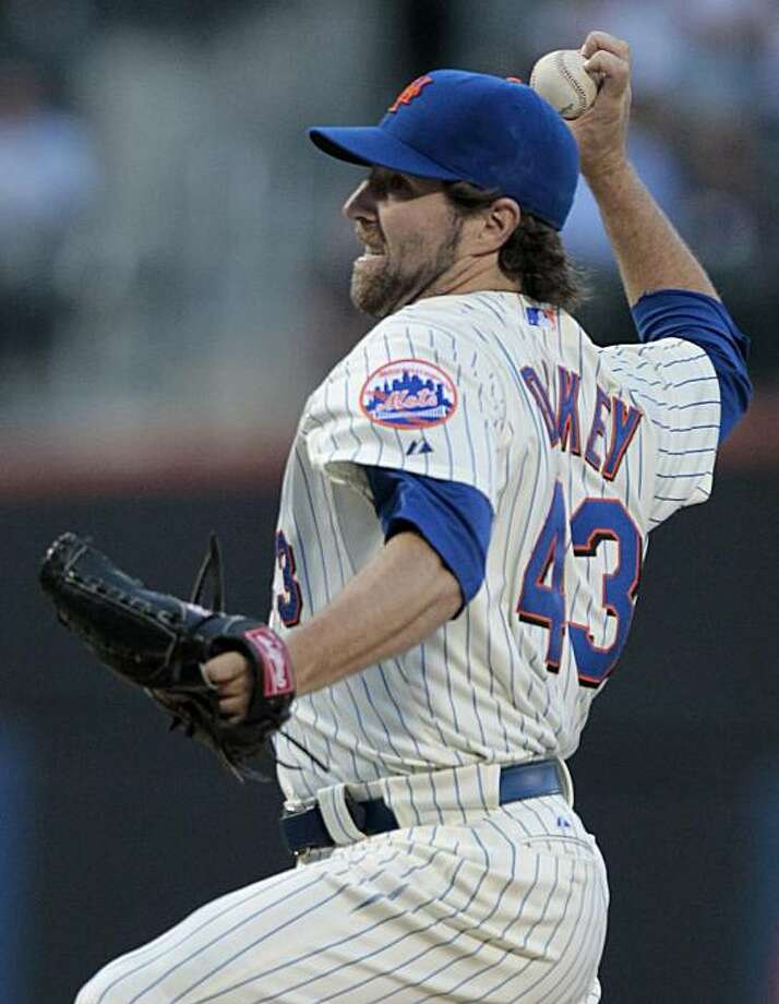 New York Mets' R.A. Dickey delivers a pitch during the first inning of a baseball game against the Philadelphia Phillies Friday, Aug. 13, 2010, in New York. The Mets won the game 1-0. Photo: Frank Franklin II, AP