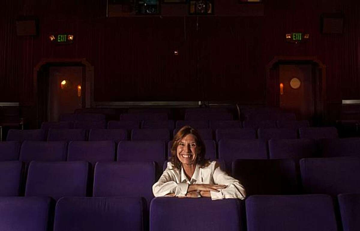 Cathy Buck, owner of the Cameo Cinema in St. Helena, poses in the theater on Thursday, Aug. 5, 2010. Buck took over the 97-year-old theater three years ago, and offers an eclectic mix of new releases, second-run films, and community events.