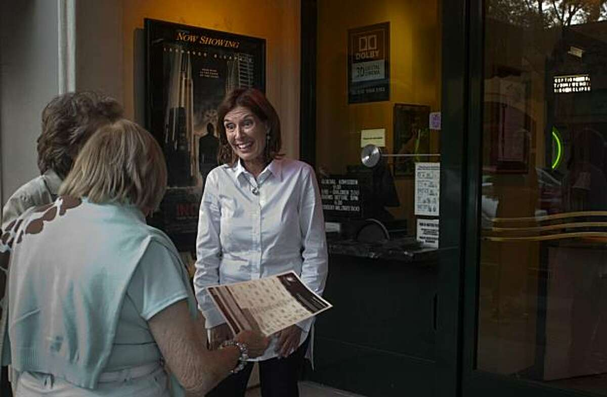 Cathy Buck, owner of the Cameo Cinema in St. Helena, talks with passers-by Thursday, Aug. 5, 2010 in front of the theater. Buck took over the 97-year-old theater three years ago, and offers an eclectic mix of new releases, second-run films, and community events.