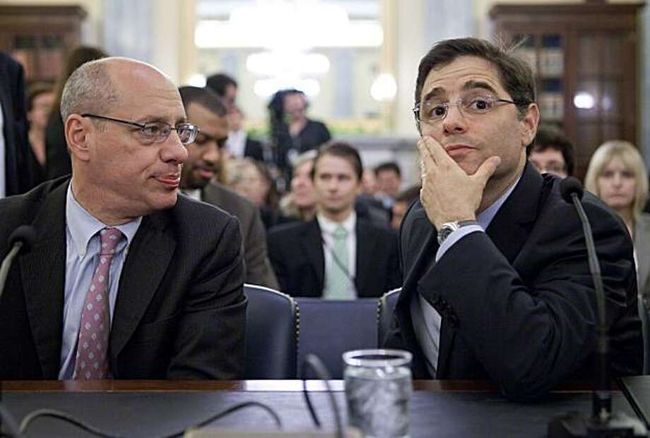 Jon Leibowitz, chairman of the Federal Trade Commission, FTC, left, and Julius Genachowski, chairman of the Federal Communications Commission, FCC, arrive to a Senate Commerce, Science and Transportation Committee hearing on consumer online privacy in Washington, D.C., U.S., on Tuesday, July 27, 2010. Internet companies should simplify their privacy policies and give computer users more power to limit the sharing of their person information, senators said. Photographer: Andrew Harrer/Bloomberg *** Local Caption *** Jon Leibowitz; Julius Genachowski Photo: Andrew Harrer, Bloomberg