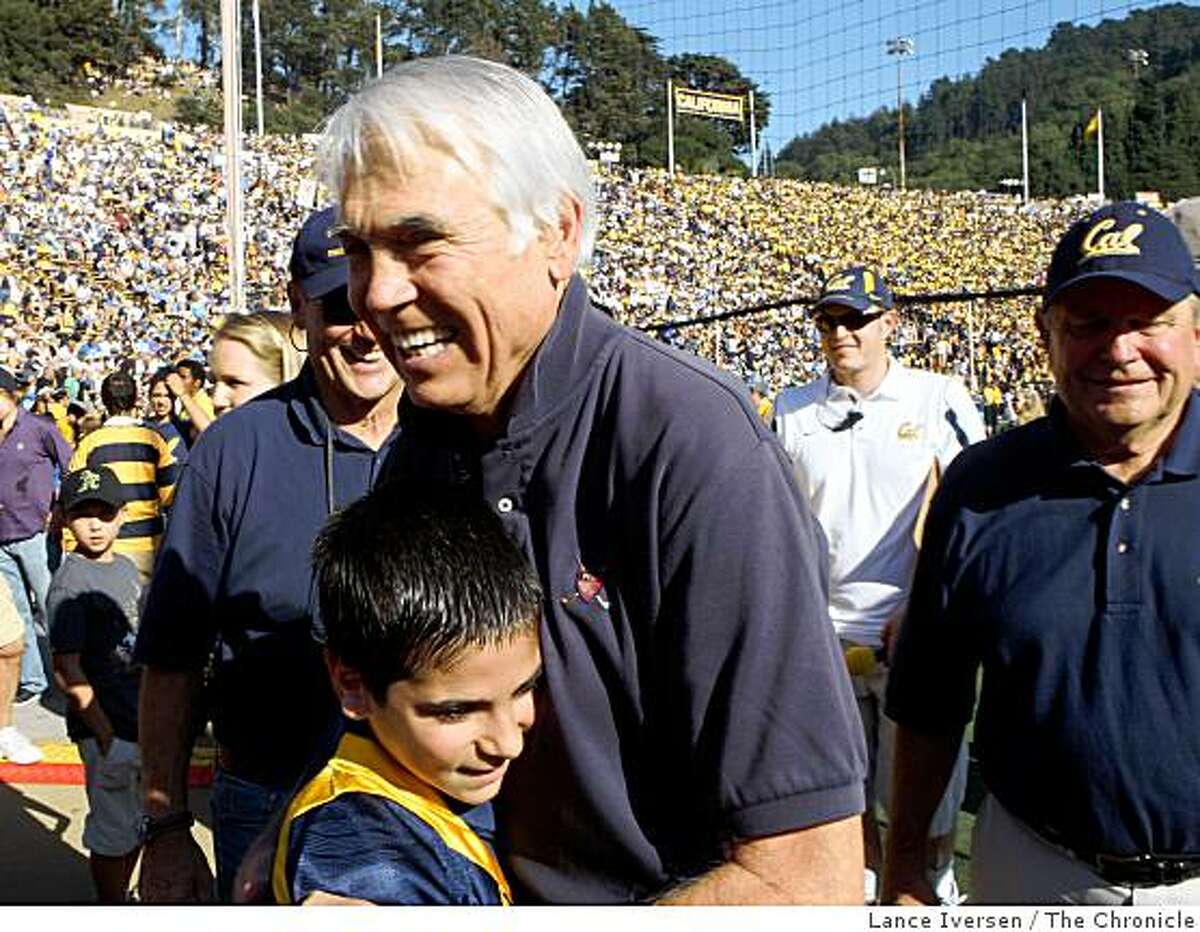 Joe Kapp, former Cal coach, NFL star, who was also the Quarterback for Cal's 1959 Rose Bowl team is greeted by THomas Bohorqve age 11 during the Cal-UCLA game Saturday October 24, 2008. Kapp was on hand for a third quarter ceremony that honored the Rose Bowl team.