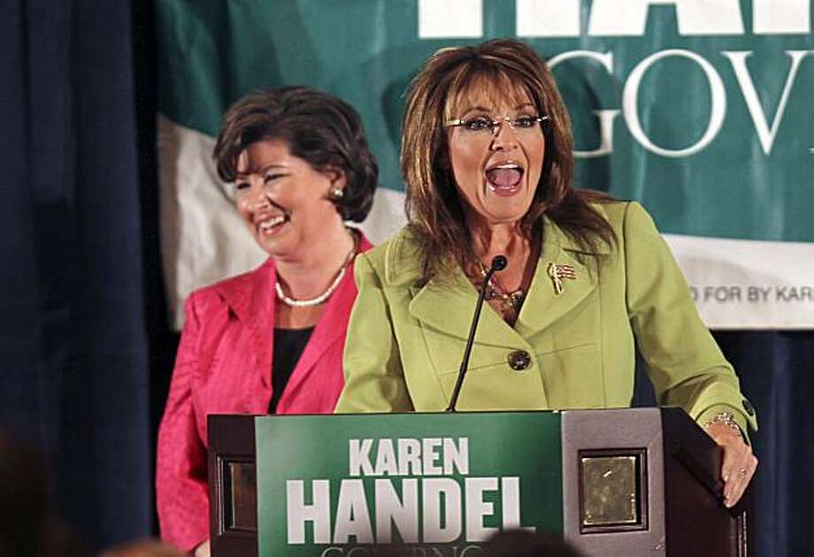Former Alaska Gov. Sarah Palin speaks during a rally for Georgia Republican gubanatorial candidate Karen Handel, background, Monday Aug. 9 2010 in Atlanta.  Handel will face Nathan Deal in a runoff Tuesday for the Republican nomination. Photo: John Bazemore, AP