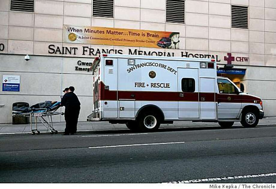 Emergency responders with the San Francisco Fire Dept. wheel a patient into the ER at St. Francis Memorial Hospital on Dec. 12 ,2008 in San Francisco, Calif. Photo: Mike Kepka, The Chronicle