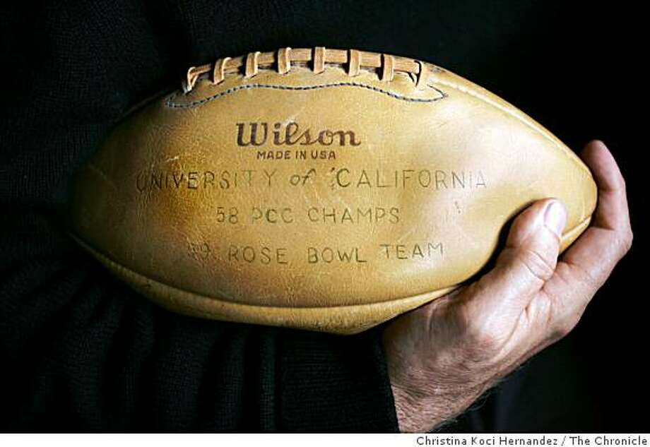 reunion09060_ckh.jpg Bates' football.Berkeley mayor, Tom Bates, at his home..About 30 members of UC Berkeley's 1958 Pacific Conference champion football team, which went to the Rose Bowl, are getting together for a reunion this weekend. Berkeley Mayor Tom Bates, as well as famed coach Joe Kapp, were players. Bates is hanging out today with some players, and he has a program showing himself and other players back in the day that we can get historical pictures from. Photo: Christina Koci Hernandez, The Chronicle
