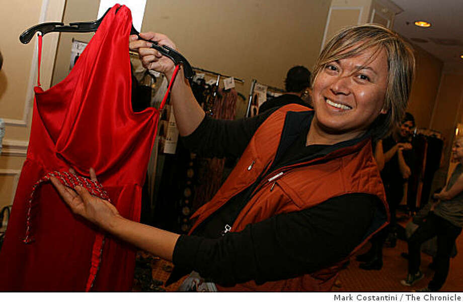 San Francisco fashion designer Joseph Domingo is holds a dress  while preparing to for a fashion show in San Francisco, Calif. on Thursday, December 4, 2008. Photo: Mark Costantini, The Chronicle
