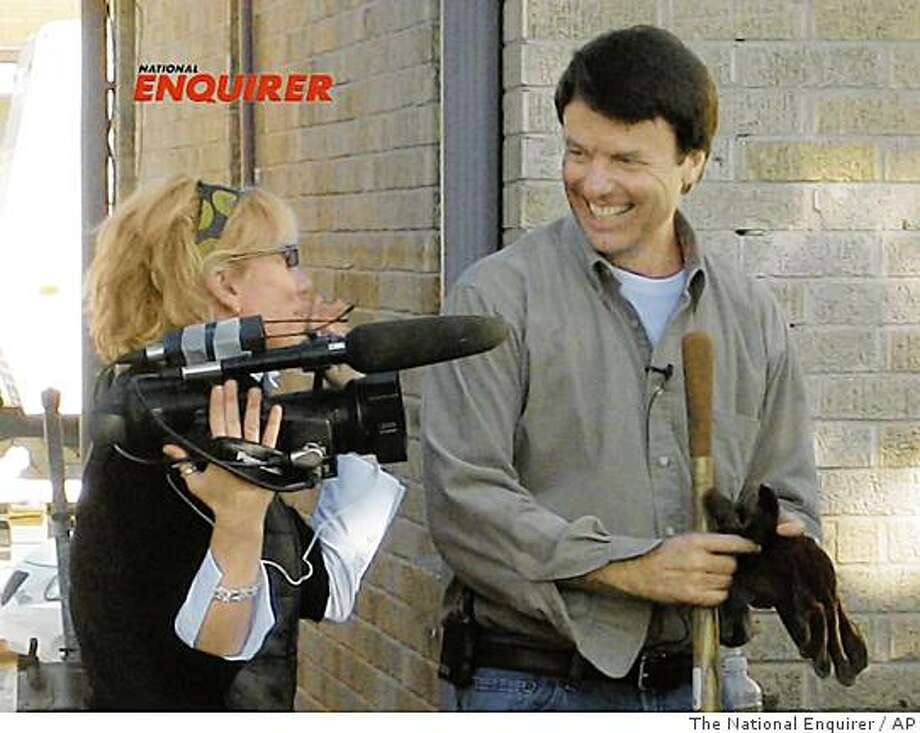 In this Dec. 27, 2006 photo provided by the National Enquirer, former U.S. Sen. John Edwards, D-NC, is shown with videographer Rielle Hunter in the 9th Ward of New Orleans, La. On Friday, Aug. 8, 2008, Edwards admitted to having an affair with Hunter. (AP Photo/The National Enquirer) Photo: The National Enquirer, AP