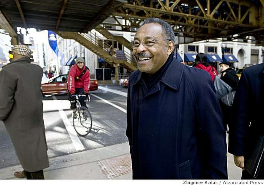 Roland Burris talks to bystanders along State Street after leaving the ABC Channel 7 studios Wednesday, Dec. 31, 2008, in Chicago. Roland Burris has been tapped by Gov. Rod Blagojevich to replace President-elect Barack Obama in the Senate. Photo: Zbigniew Bzdak, Associated Press