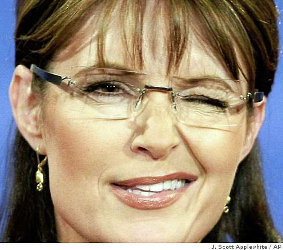 ** FOR USE AS DESIRED WITH YEAR END--FILE **In this Oct. 2, 2008 file photo, Republican vice presidential candidate Alaska Gov. Sarah Palin winks as she speaks during her vice presidential debate against Democratic vice presidential candidate Sen. Joe Biden, D-Del., at Washington University in St. Louis, Mo.  (AP Photo/J. Scott Applewhite/FILE) Photo: J. Scott Applewhite, AP