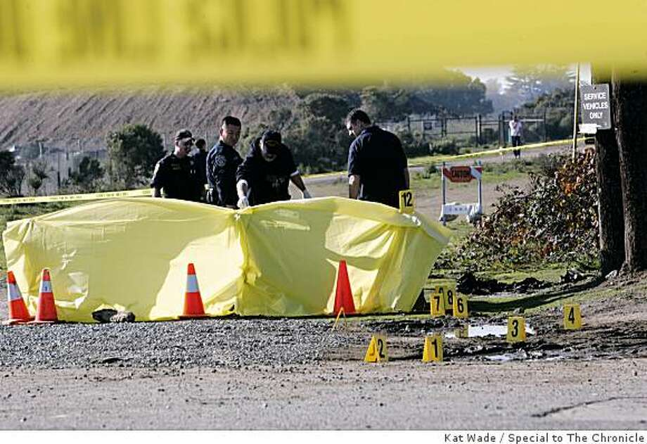 Berkeley Police, Alameda County Sheriffs and Alameda County coroners examine the scene where the burnt remains of a body were discovered. Photo: Kat Wade, Special To The Chronicle