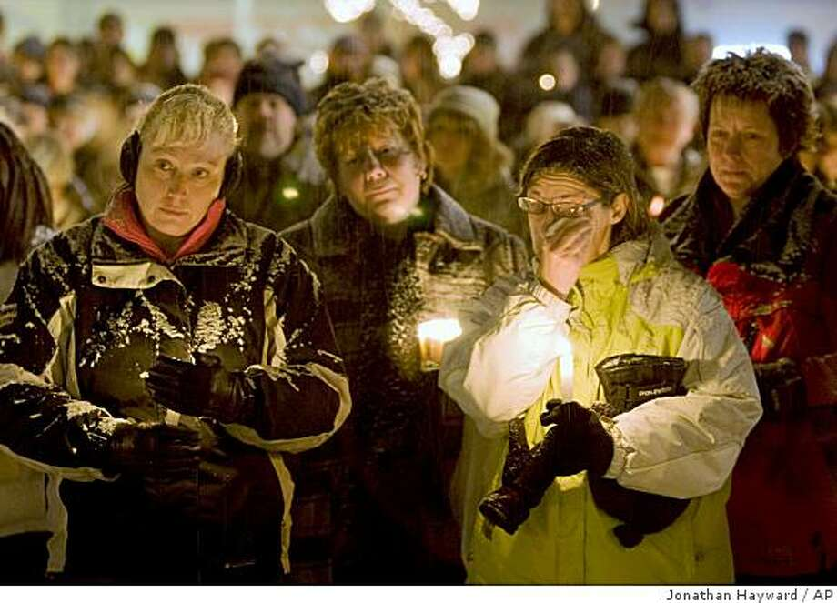 Mourners gather at a candlelight vigil in Sparwood, B.C., Canada on Monday, Dec. 29, 2008 to commeorate those who lost their lives in the recent avalanches.  Eleven men were caught in the two avalanches, including two who were able to dig themselves and a third man out. The second slide happened as four snowmobilers were trying to rescue seven others who had just been caught in the first avalanche. (AP Photo/The Canadian Press, Jonathan Hayward) Photo: Jonathan Hayward, AP
