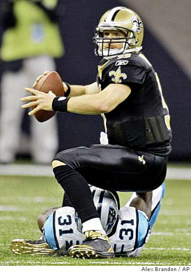 New Orleans Saints quarterback Drew Brees  (9) is sacked by Carolina Panthers defender Richard Marshall (31) in the second half of their NFL football game in the Superdome in New Orleans, Sunday, Dec. 28, 2008. (AP Photo/Alex Brandon) Photo: Alex Brandon, AP