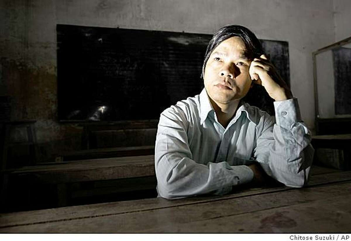 Do Viet Khoa, a high school math and geography teacher, is shown in his house in Thuong Tin district in Hanoi, Vietnam, Wednesday, Dec. 10, 2008. Khoa has been trying to root out the petty bribery and cheating that plaques schools across Vietnam, where poorly paid teachers and administrators squeeze money out of impoverished parents who can't afford to pay but feel they have no choice.