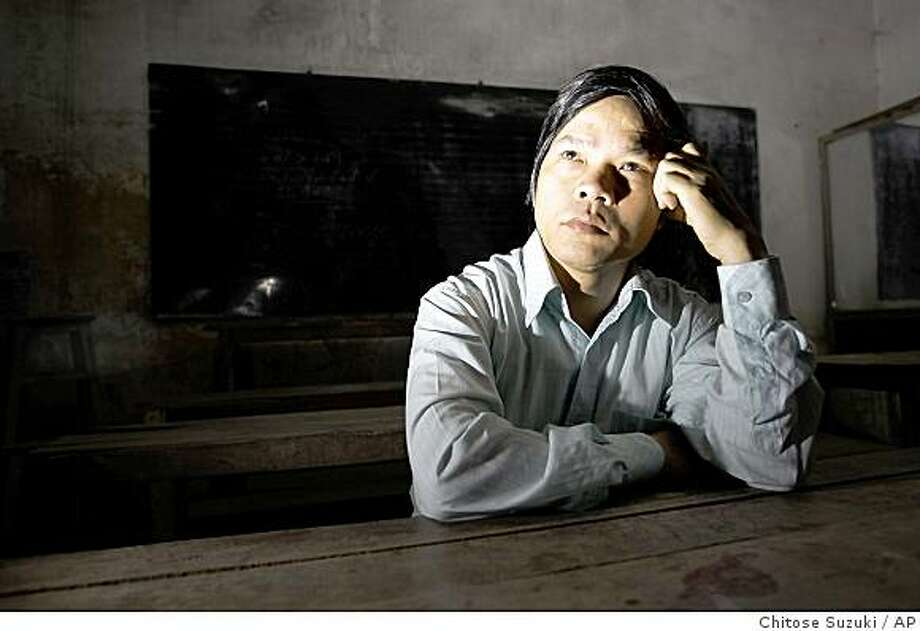 Do Viet Khoa, a high school math and geography teacher, is shown in his house in Thuong Tin district in Hanoi, Vietnam, Wednesday, Dec. 10, 2008. Khoa has been trying to root out the petty bribery and cheating that plaques schools across Vietnam, where poorly paid teachers and administrators squeeze money out of impoverished parents who can't afford to pay but feel they have no choice. Photo: Chitose Suzuki, AP