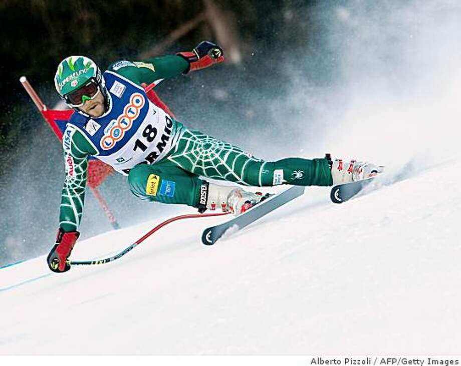 US Bode Miller  speeds down during the training of downhill race as a part of FIS men's ski worldcup in Bormio on December 27,  2008. Austrian Michael Walchhofer clock the best time ahead of Italian Werner Hell and Swiss Ambrosi Hoffmann .  AFP PHOTO / ALBERTO PIZZOLI (Photo credit should read ALBERTO PIZZOLI/AFP/Getty Images) Photo: Alberto Pizzoli, AFP/Getty Images