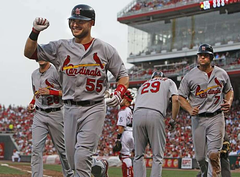 St. Louis Cardinals' Skip Schumaker (55) celebrates after hitting a grand slam home run off Cincinnati Reds pitcher Mike Leake in the fourth inning of a baseball game Monday, August 9, 2010 in Cincinnati. Cardinals players Colby Rasmus (28), Chris Carpenter (29), and Matt Holliday (7) are seen in background. The Cardinals won 7-3. Photo: Gary Landers, AP